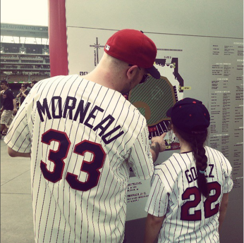 Showing our niece (and future-baby's cousin) Gwen the ropes at Target Field, summer 2013.